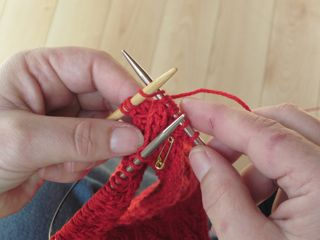 Knitting stitches off cable needle